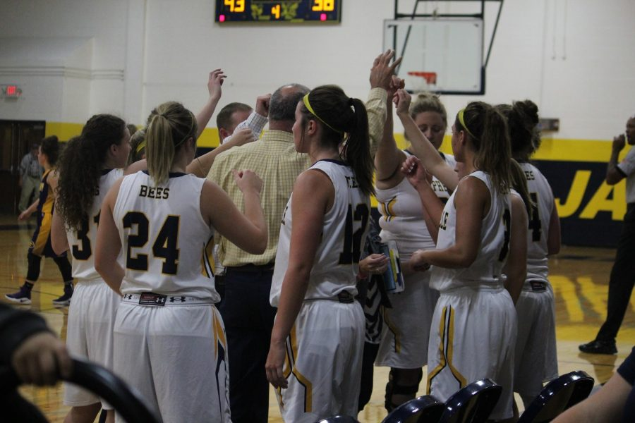 The Honeybees come huddle before the game and continue their successful season