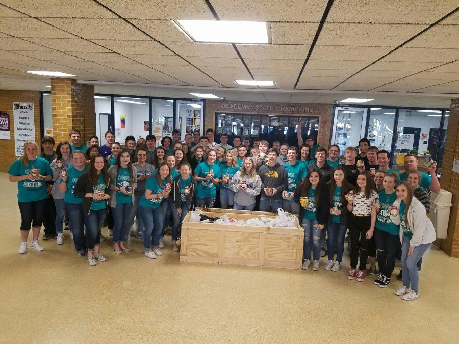 Student council collects cans of food to donate at the Grace Place.