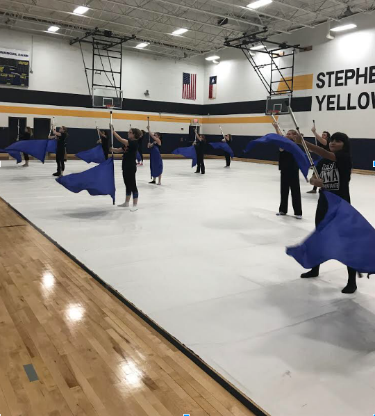 Winterguard practices their routine for Friday's performance.