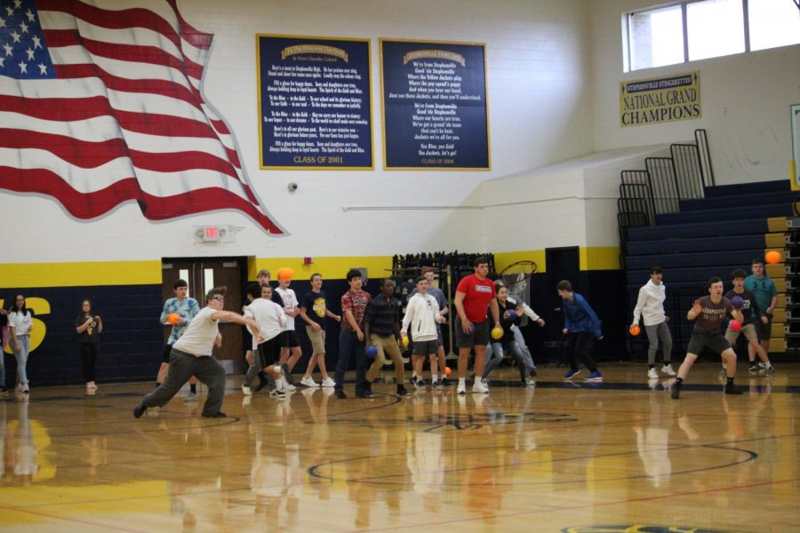 Teachers and students participate in FCA dodgeball game during action March 22nd.