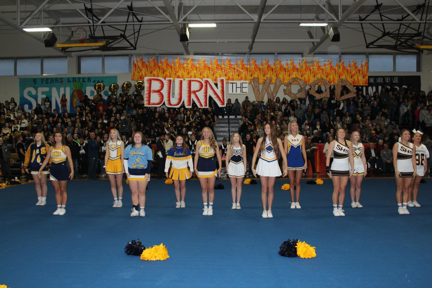 Students rev up the crowd at the Throw Back Pep Rally for the 'Burn the Wood' game.