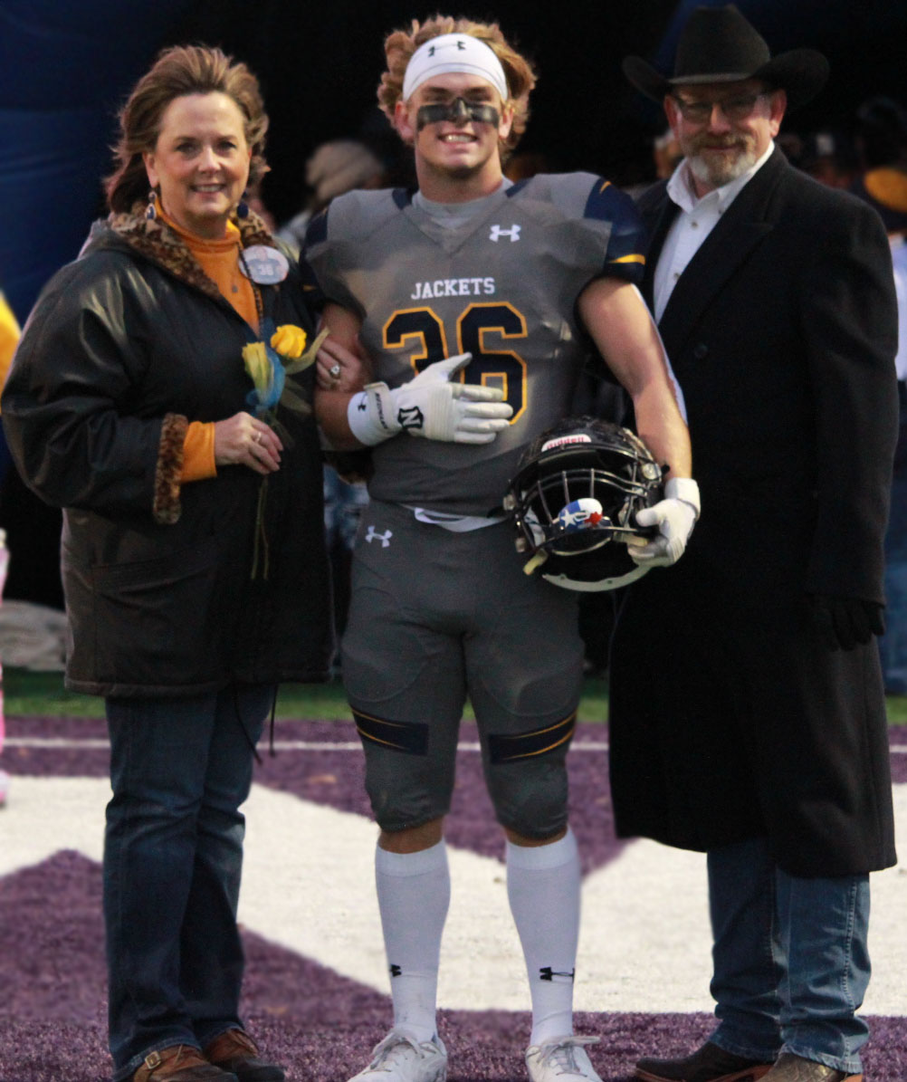 Seniors take a last walk across Memorial Stadium with their parents during the Stephenville vs Brownwood game on Oct. 25, 2019