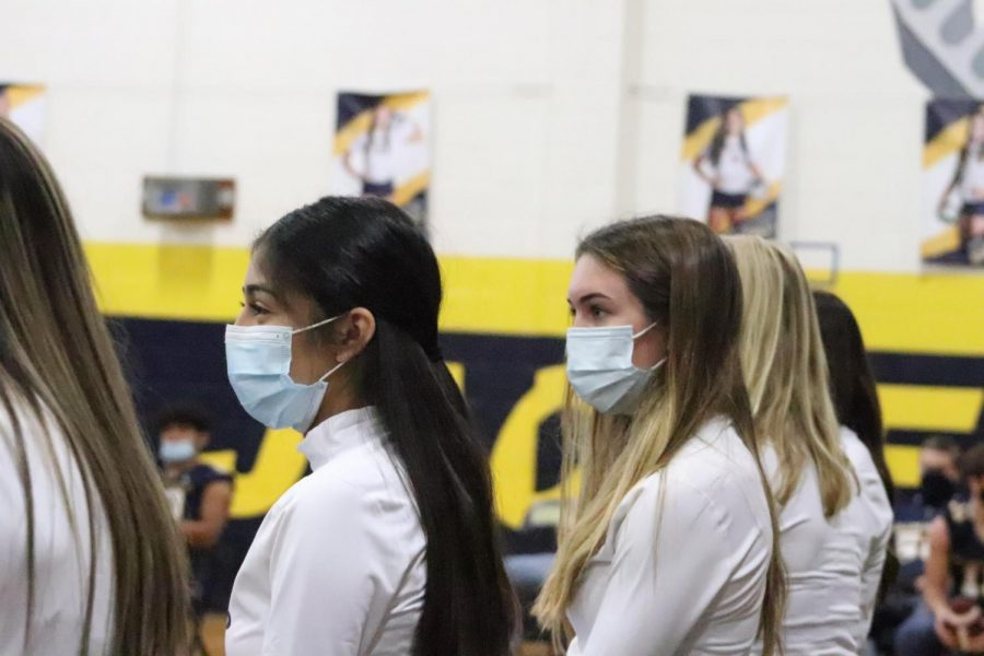 Students participate in a pep rally by wearing face masks and social distancing due to the coronavirus pandemic.