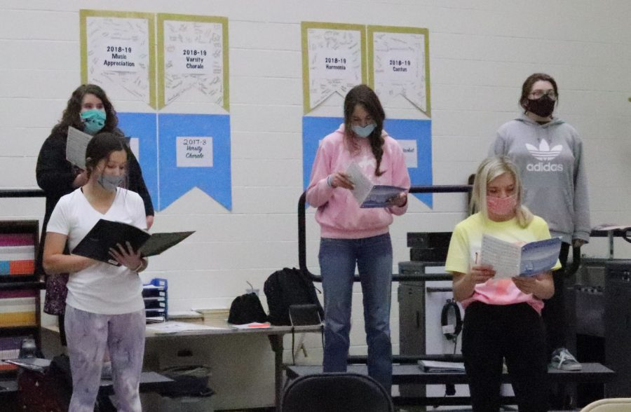 Choir students attend class and practice while wearing masks and staying six feet apart in the 2021 school year.