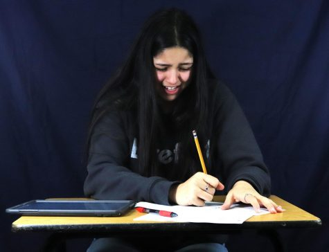Olivia Mendoza works on 2021 school assignments from home as she struggles to understand what she needs to do to complete the lesson.